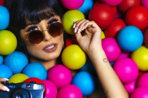 woman surrounded by coloured balls for hen party bingo game