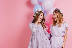 Two girls in boho outfits celebrating because they booked a hen party Galway
