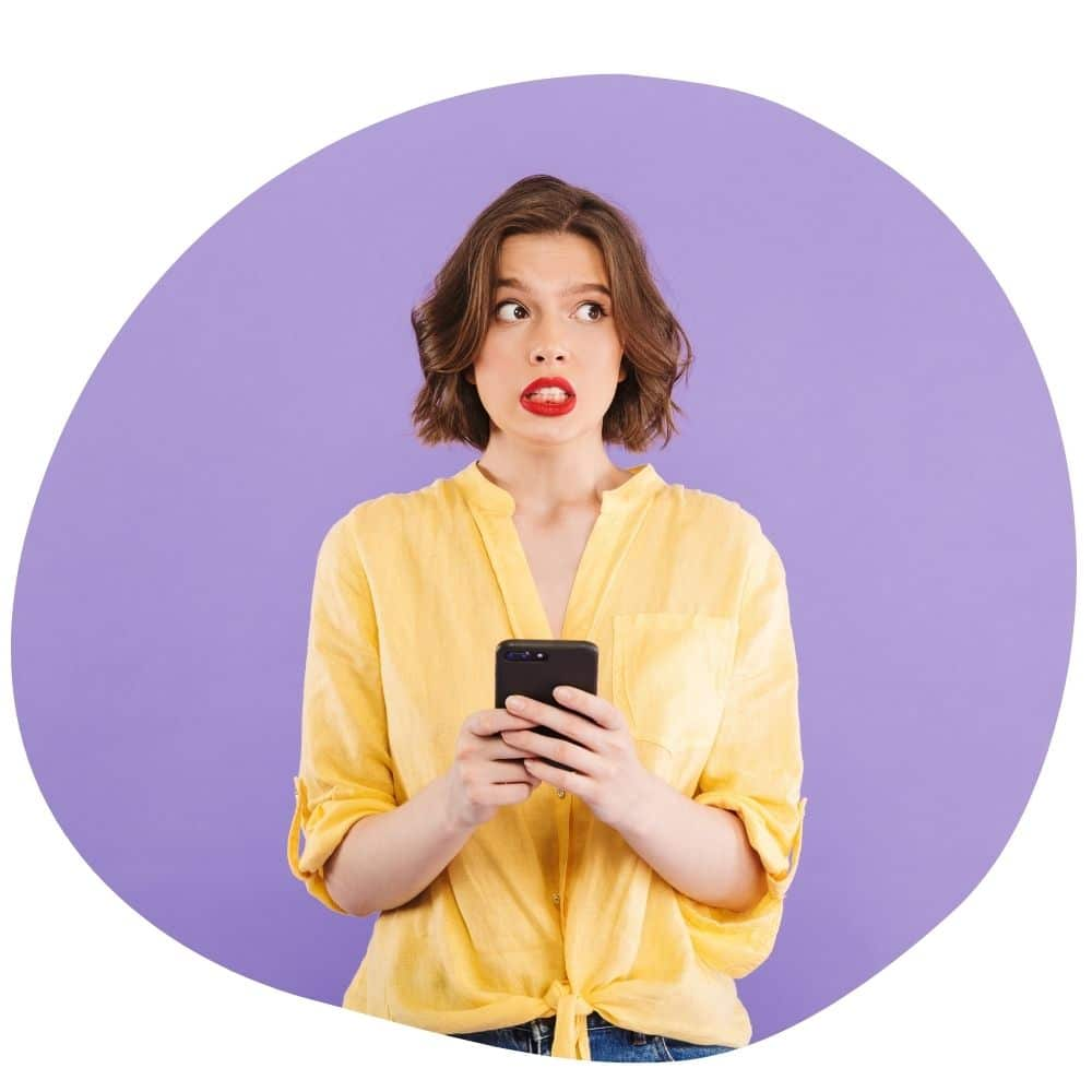 A woman holding a phone wondering with questions about her hen party ideas