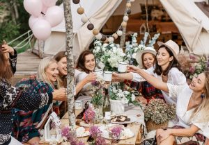 A picnic showing boho hen party decoration ideas like balloons and flowers