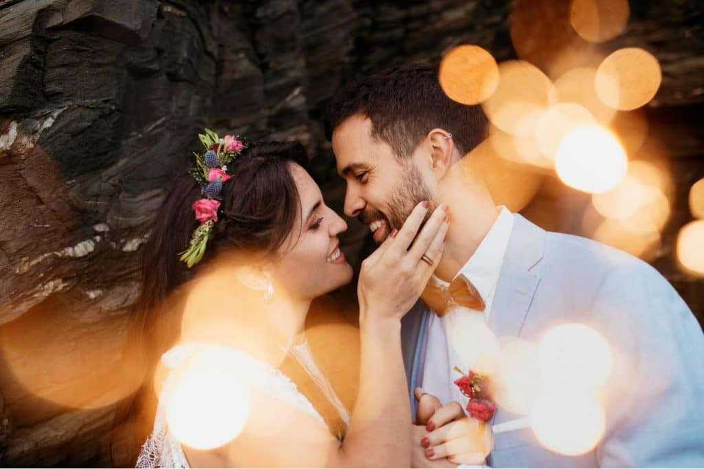 A bride and groom having a private moment as part of their wedding day tips